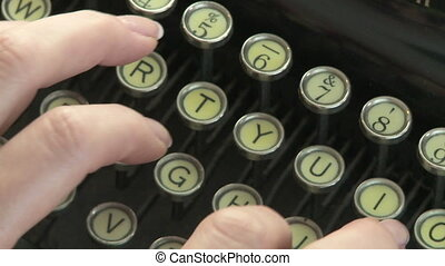 Woman types on vintage typewriter