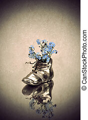 Antique vase with blue flowers