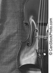 Antique violin closeup against gray fabric background