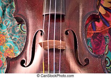 Antique violin closeup against white