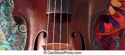 Antique violin closeup, extreme widescreen size.