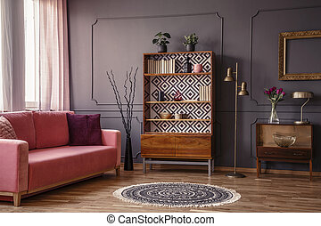 Antique wooden bookcase with decorations in an elegant gray...