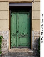 Antique wooden door with decorative elements