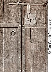 Antique wooden door with old classic iron lock. Vintage