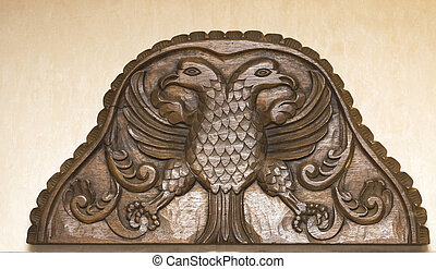 Antique wooden headboard with eagles