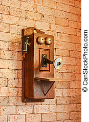 Antique wooden telephone, Vintage Telephone on grungy background of a brick wall, Retro Phone
