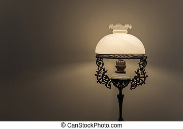 Antiques lamp on dark background.