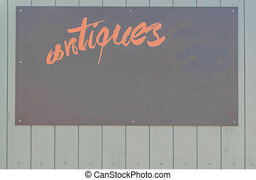Antiques sign on a wooden surface