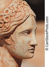 antiquity - beautiful terracotta female face profile, Italy
