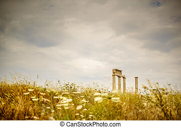 Antiquty Under Threat - A Greek temple sits under...