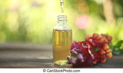 antirrhinum, essentiële olie, in, mooi, fles, op, tafel
