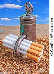 Antismoking background with broken cigarettes and a padlock