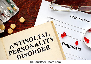 antisocial personality disorder written on book with...
