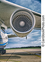 Antonov 225 Mriya airplane motor while loading heavy weight...