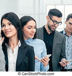 användande, grupp, folk, smartphones, mångfaldig, deras, affär