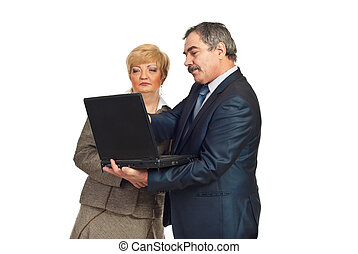 användande laptop, mogna, affärsfolk