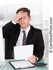 Anxiety businessman sitting in office - Portrait of Anxiety...