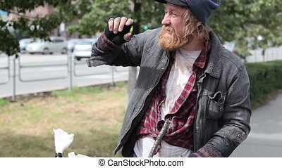 Close-up of a tramp looking around with anxiety