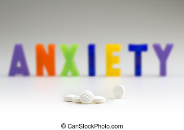 anxiolytics - white tablets and anxiety word blurry