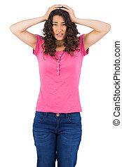 Anxious attractive brunette posing