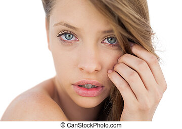 Anxious brunette model posing looking at camera