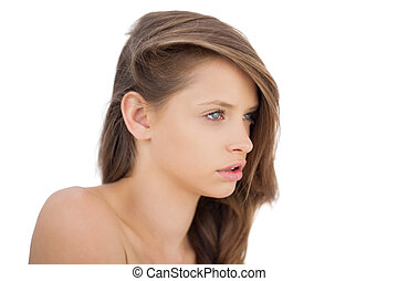 Anxious brunette model posing looking away