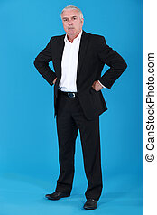 anxious businessman standing on blue background