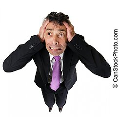 Anxious businessman tearing at his hair - High angle full...