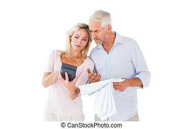 Anxious couple working out their bills