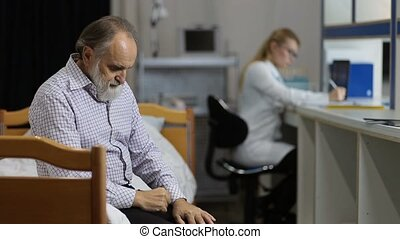Anxious patient waiting for medical test in clinic - Anxious...