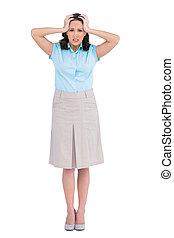 Anxious stylish businesswoman posing on white background