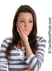 Anxious Woman - Anxious woman holds her face with concern.
