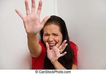 anxious woman symbol of violence in the family - Timid woman...
