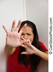 anxious woman symbol of violence in the family