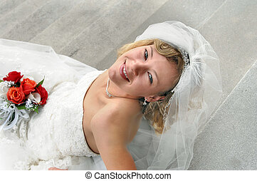 Anxiously awaiting Ceremony - Bride sits on the steps of the...