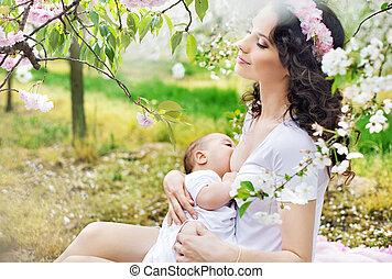 anya, élelmezés csecsemő, alatt, a, gyümölcsöskert