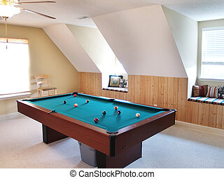 Anyone For Pool - A pool table in a bonus room in a modern...