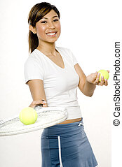 A young woman with tennis racket and balls
