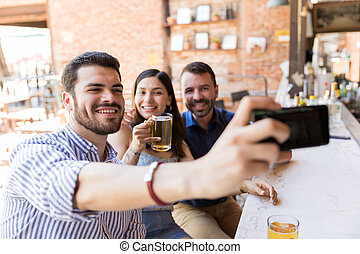 Anytime Is Selfie Time - Smiling friends taking selfie on ...