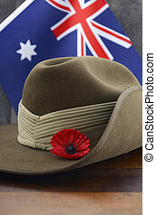 Anzac army slouch hat with Australian Flag on vintage wood...
