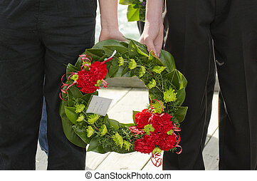 Anzac Day - War Memorial Service - An ANZAC flower wreath in...