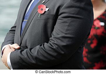 Anzac Day - War Memorial Service - Close up of an ANZAC red...