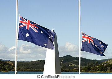 Anzac Day - War Memorial Service - The national flags of...