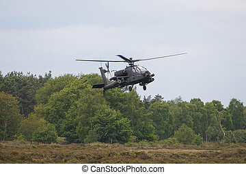 Apache hoovering above the ground