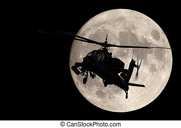 Apache helicopter silhouetted by a full moon