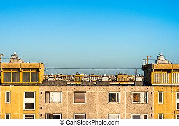 Apartment against blue sky