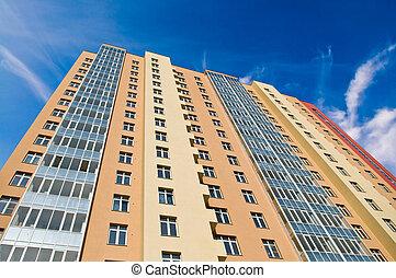 apartment block over blue sky