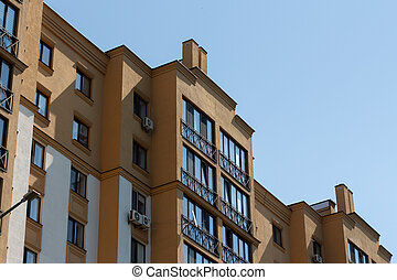 apartment building on a background of blue sky