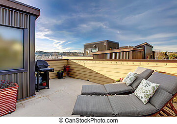 Apartment building roof top terrace exterior.
