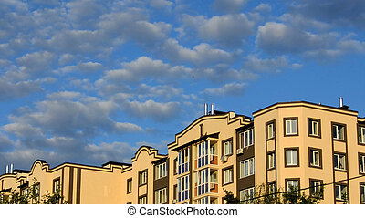 apartment building on beautiful blue sky background